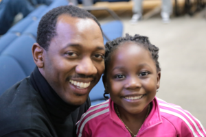 Daddy with his daughter smiling